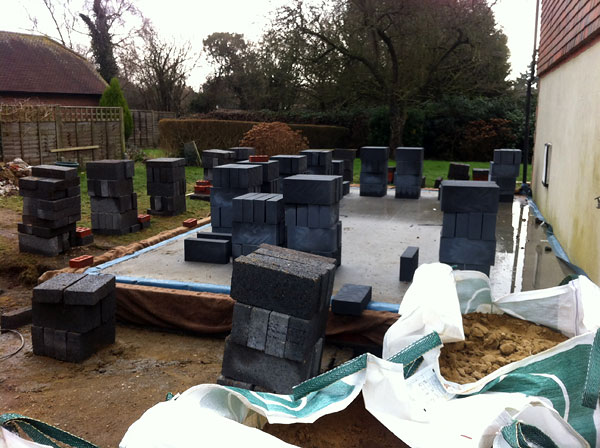 Climping: Floor over site poured with concrete and ready for brick and block - During