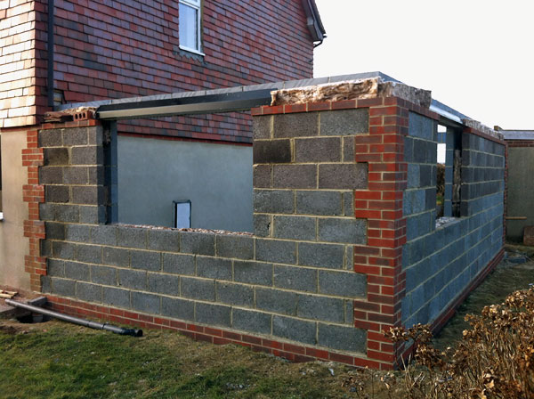 Climping: Walls built to full height at growing floor extension - During