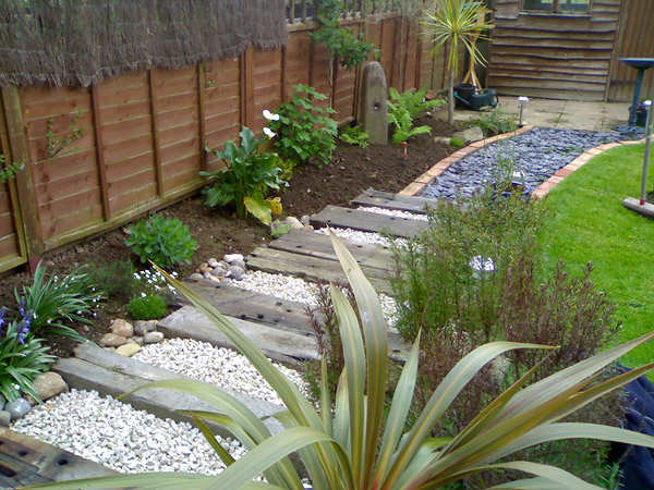 Middleton on Sea: New landscaped path with Cotswold stone, slate, reclaimed brick and railway sleepers - After