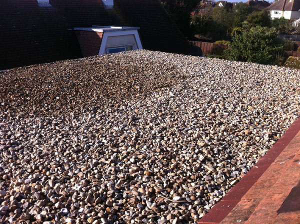 Felpham: Roofing project - EDPM flat roof covered with pebbles for fireproofing purposes